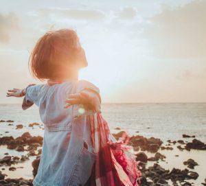 woman embraces the dawn